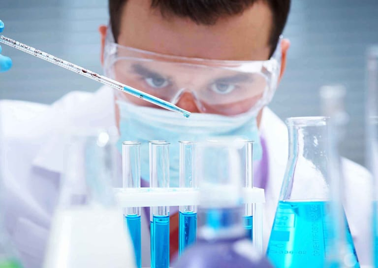 scientist observing chemicals